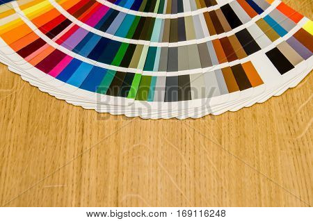 Pantone Color Palette Guide On Wooden Board Close Up View