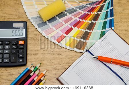 Color Swatches, Pencil, Pen, Notebook, Calculator On Wooden Table