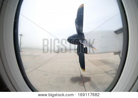Detail of the propeller airplane at the airport. Plane motor with propeller.