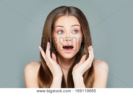 Surprised Model Woman with Open Mouth. Surprise concept