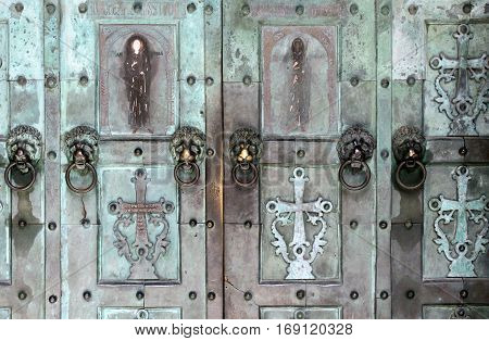 Old doors of Catholic temple closeup / vintage church door / doors from religious premises closeup