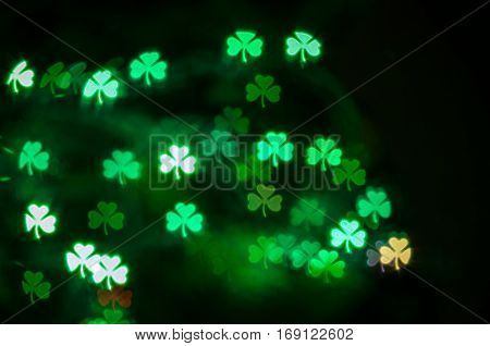 St Patricks Day green shamrock bokeh background. Bokeh of St Patricks Day. St Patricks Day light background. St Patricks Day trefoil bokeh