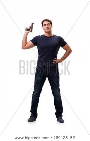 Aggressive young man with gun isolated on white