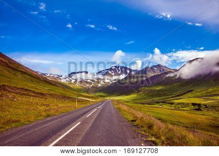 The concept of extreme northern tourism. Summer tour in the Nordic countries. The Iceland  highway in Tundra