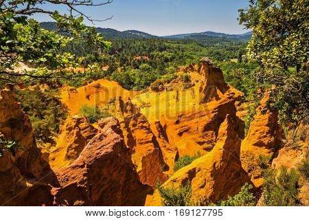 Languedoc - Roussillon, Provence, France. The reserve - a pit on production ochre. Orange and red picturesque hills