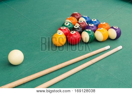 Snooker Billards Pool Balls And Cue Stick On Green Table