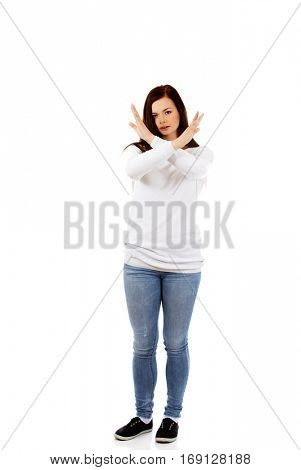 Young angry screaming woman gesturing stop sign