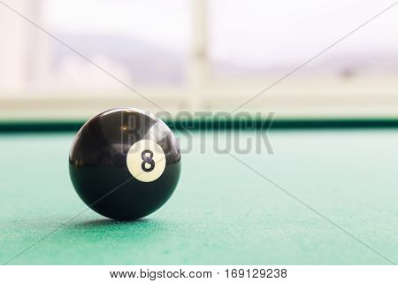 Closeup Black Snooker Billards Ball On Table With Green Surface