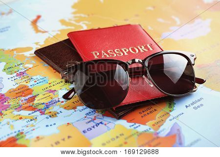 Adventure concept. Sunglasses and passports on map
