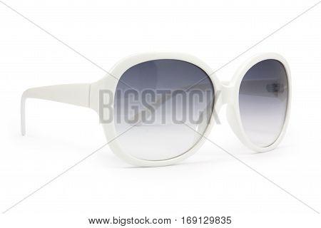 Beautiful white sunglasses on white background .