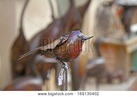 Besalu Spain - September 09 2014: Decorative bird made of metal for sale on the old street in Besalu Spain