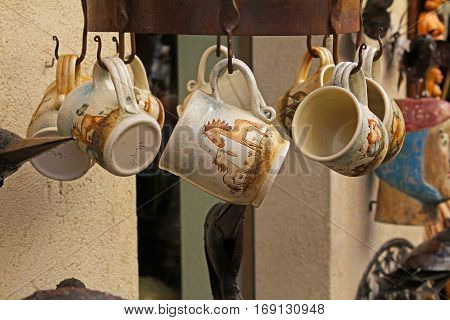 Besalu Spain - September 09 2014: Handmade ceramic mugs on street market in Besalu