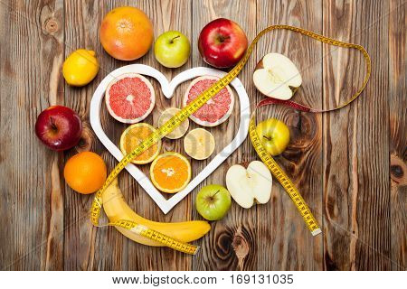 Fruit Diet, Centimeter And A Heart On  Wooden Background