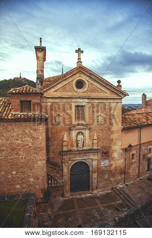 CUENCA SPAIN - SEPTEMBER 30 2013: Church of San Pedro. Cuenca was declared a World Heritage site in 1996. Old town is an outstanding example of a medieval city built on the steep sides of a mountain