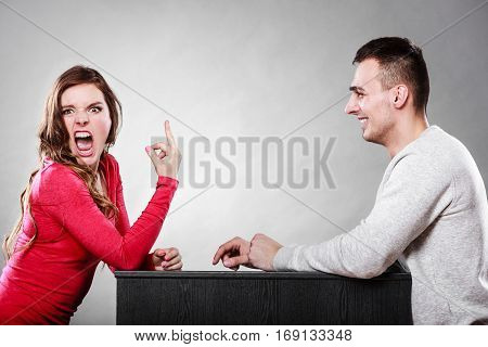 Woman Showing Middle Finger Gesture To Man