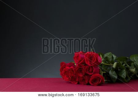 roses boquet an red table with dark background