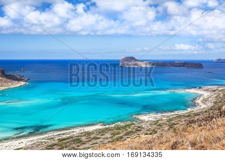 Picturesque view on Balos bay Gramvousa island and sea lagoon with clear limpid turquoise water on a bright sunny day looks like a paradise. Crete Greece.