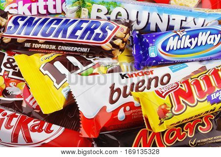 MOSCOW - DECEMBER 10 2014: This is a studio shot of a variety chocolate bars including Snickers, Bounty, Mars, Kinder Bueno, Milky Way.