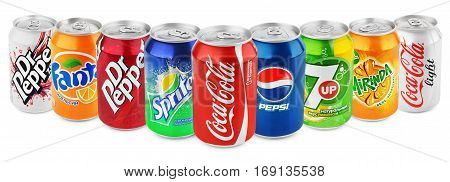 MOSCOW - DECEMBER 13 2014: Group of various brands of soda drinks in aluminum cans isolated on white with clipping path. Brands included in this group are Coca Cola Pepsi Sprite Fanta 7up Mirinda Dr Pepper