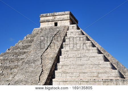 Temple at Chichen Itza Mexico with one half resored