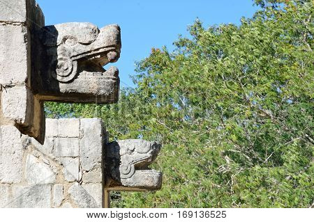 Animal statues in wall at Chichen Itza