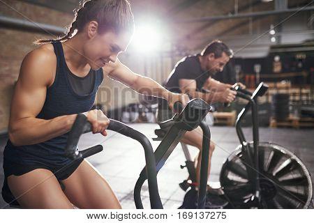 Two People Training In Effort On Simulators
