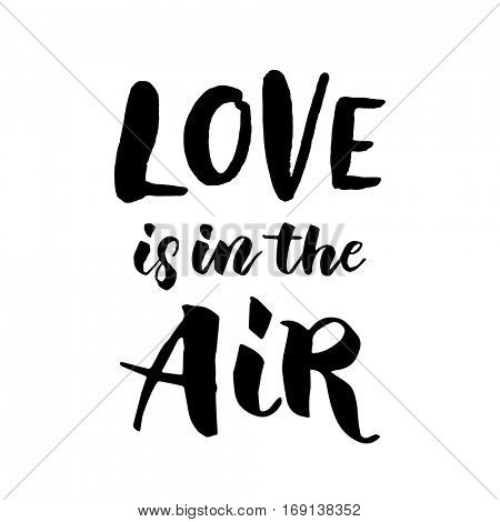 Love is in the air hand drawn text calligraphy for Valentine Day greeting card. Black calligraphic vector font on white background. Happy Valentines 14 February heart love congratulation art design