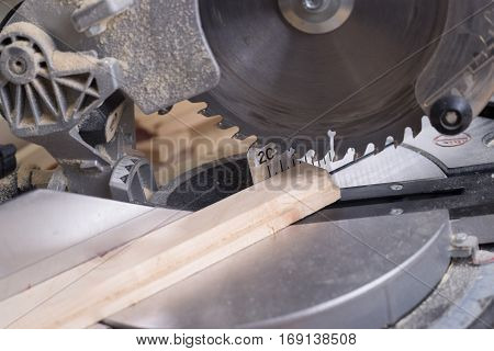 Carpenter tools on wooden table with sawdust. Circular Saw. Copy space.