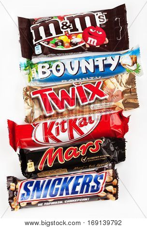 MOSCOW - DECEMBER 5 2014: Closeup of various chocolate bars - Snickers, Mars, Twix, Bounty, M&M's