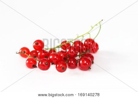 Ripe red currant berries. Side view. Isolated on white background.