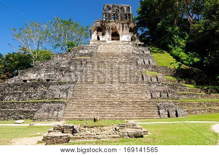 Ancient city of Palenque sits like a king on a throne of jungle where plains meet mountains. Mexico