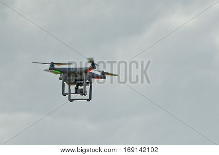 Quadro-copter conducts supervision and a video shooting from height of the bird's flight.