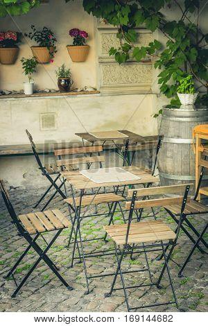 Cozy tables sidewalk cafe outdoor. Toned, closeup