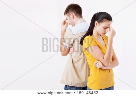 Man and woman standing back to back after quarrel isolated