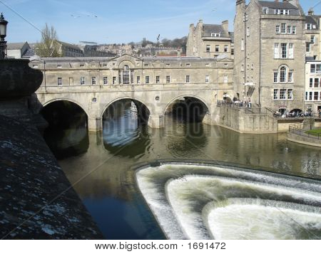 Pulteney Bridge is a bridge that crosses the River Avon located in Bath England and completed in 1773. poster