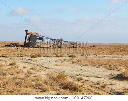 Old rig which fell. Landscape, desert, ground.