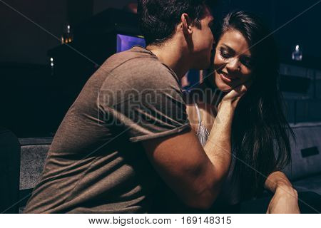 Young couple in love at the night club. Romantic couple at pub.
