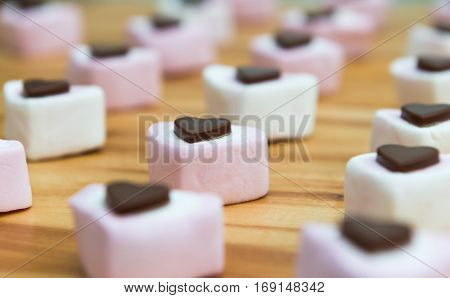 Heart Shaped Sweets On A Wooden Kitchen Worktop. Close Up.