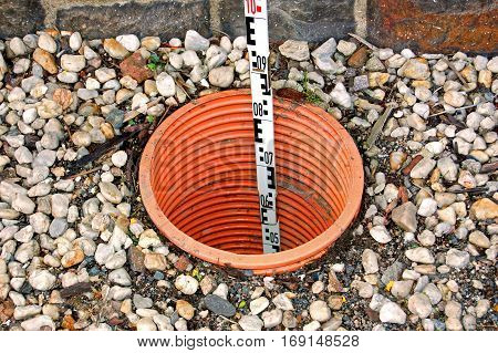 Measurement on a drainage opening of a building