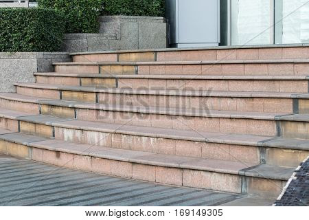 Ancient marble staircase frontal view. Old staircase