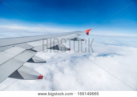 view of beautiful sky with aircraft wing from aircraft window