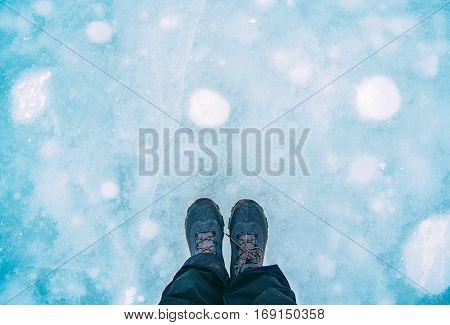 Traveler standing on ice sheet. in winter season