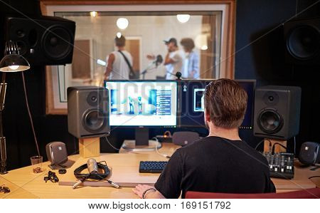 Music band during cd recording in studio.