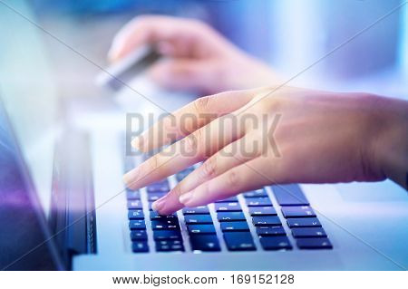 young woman hands holding credit card and using laptop for Online shopping, e-shopping, ebanking. Person buying online in internet. E-banking concept, buying online