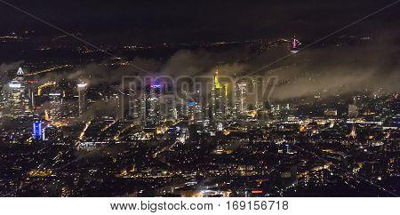night view to skyline of Frankfurt in fog