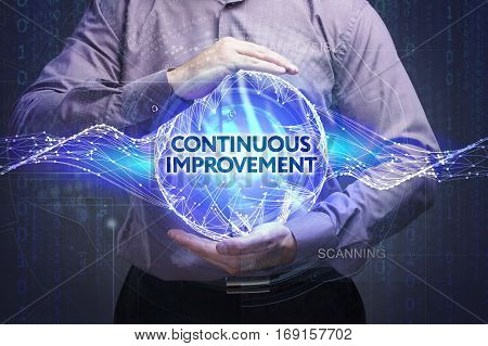 Business, Technology, Internet And Network Concept. Young Businessman Shows The Word: Continuous Imp