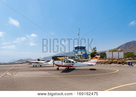 Nasca, Peru - October 9,2016: Light general aviation cessna aircrafts stand at small airport