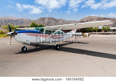 NASCA PERU - OCTOBER 92016: Light general aviation cessna aircrafts stand at small airport