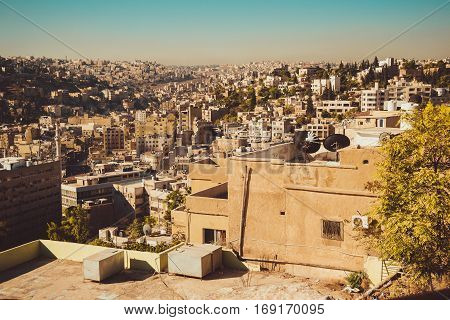 Photo of the Amman cityscape, Jordan capital. Aerial view from Citadel hill. Urban landscape. Residential area. Arabic architecture. Eastern city. Travel concept. Roofs and antennas