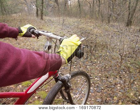 Smoking during cycling outdoors in sports fingerless gloves